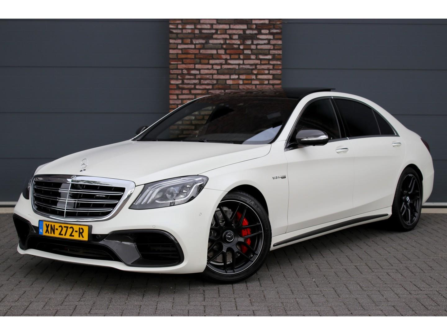 Mercedes-benz S-klasse 63 amg 4matic+ lang aut9, luchtvering, distronic+, amg carbon, panoramadak, surround view, head-up display, entertainment achter, massage, keyless-go, amg driver's package, designo kashmir wit magno, etc.